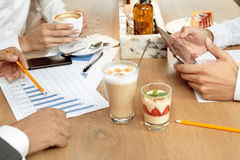 Business lunch of business partners. Business partners on a coffee break in cafe Royalty Free Stock Image