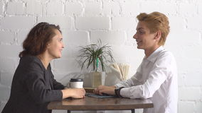Business lunch in a cafe. The meeting of two business.  stock footage