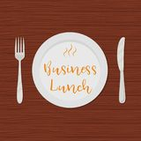 Business lunch concept. Plate with the text `Business Lunch` on a wooden background. There is also a fork and a knife in the picture. Vector illustration stock illustration