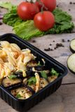 Business lunch in food boxes, roast chicken wings, steamed vegetables, stewed meat, ready meal to eat royalty free stock photos