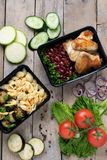 Business lunch in food boxes, roast chicken wings, steamed vegetables, stewed meat, ready meal to eat royalty free stock image