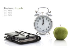 Business lunch. Fork on Filofax with Apple and Clock but no time for lunch, Business lunch Concept on a White Background with Copy Space Royalty Free Stock Photos
