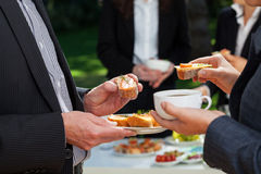 Business lunch in the garden Royalty Free Stock Images