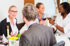 Business lunch in restaurant with food and wine Royalty Free Stock Photos