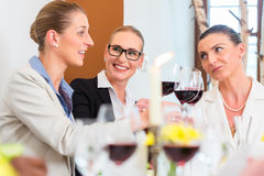 Business lunch in restaurant with food and wine Stock Photos