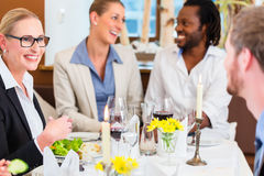 Business lunch in restaurant with food and wine Stock Photo
