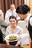 Business lunch restaurant waitress serving woman Stock Photography