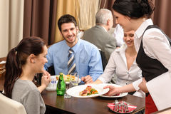 Business lunch restaurant waitress serving woman Royalty Free Stock Photos