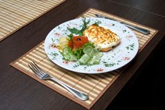 Business lunch on the table in the restaurant and cutlery Royalty Free Stock Images