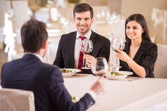 Business lunch. Team meeting in restaurant, eating and drinking in celebration of good work together Stock Photo