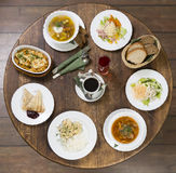 Business lunch on a vintage round table. Monday Royalty Free Stock Images