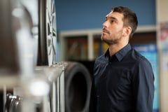 Male customer choosing wheel rims at car service Stock Photo