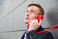 Business making hotline call Royalty Free Stock Photography