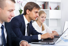 Business male assistant with coworkers stock photo