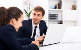 Business male assistant wearing formalwear using laptop stock image