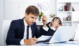 Business male assistants making mistake Stock Images