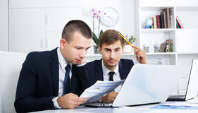 Business male assistants making mistake Royalty Free Stock Photography