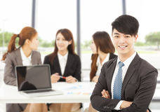 Business male manager with teams in the office. Smiling business male manager with professional teams in the office Stock Images