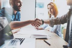 Business male partnership handshake concept.Photo two coworkers handshaking process.Successful deal after great meeting. Horizontal, blurred background royalty free stock photography