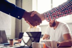 Business male partnership handshake concept.Photo two mans handshaking process.Successful deal after great meeting. royalty free stock photography