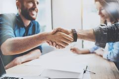 Business male partnership handshake concept. Photo two mans handshaking process. Successful deal after great meeting. Horizontal, blurred background stock images