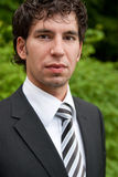 Business man. Portrait of a young business man wearing a suit Stock Photos
