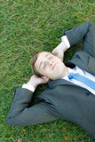 Business man. A business man lying on the grass Royalty Free Stock Photos