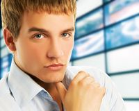 Business man. Handsome young business man over abstract background Stock Images