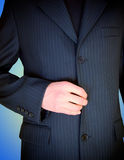 Business man. Businessman unfastens button of his jacket Royalty Free Stock Photo