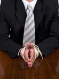 Business man. Businessman tied hands sitting at the desk decide the problem stock photos