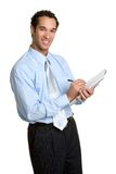 Business Man. Isolated business man taking notes Royalty Free Stock Photos