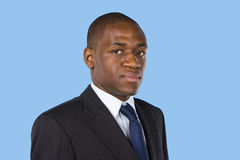 Business man. Portrait of serious business man on a blue background Royalty Free Stock Images
