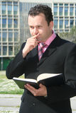 Business man. In the middle of writing and thinking up the business building Royalty Free Stock Photo