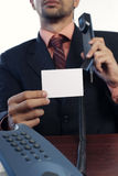 Business man. With telephone and white card on white background Royalty Free Stock Images