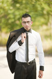 Business man. Young business man with attitude in park Stock Image