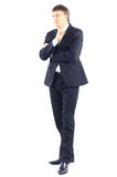 Business man. Full length portrait of a young businessman standing with his hands in the pockets Stock Images