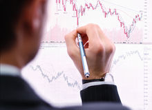 Business man. Showing chart bar / Economy and Finance concept Stock Photography