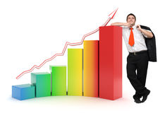 Business man - 3d rainbow financial graph. Confident business man standing near a 3d financial graph - Image on white background with soft shadows Stock Image