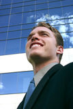 Business Man. Looking up standing in front of a business building Stock Images