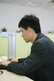 Business man. Asian Business man in black working with a laptop Stock Images