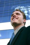Business Man. Looking up standing in front of a business building Royalty Free Stock Images