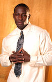 Business man. African american male with shirt and tie fingers interlocked Royalty Free Stock Image