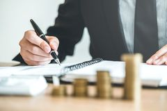 Business man Accounting Calculating Cost Economic budget investm royalty free stock photo