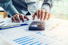 Business man Accounting Calculating Cost Economic concept Stock Images