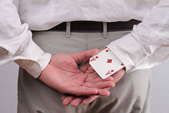 Business man with an ace up his sleeve. Business and finance. Royalty Free Stock Images