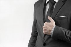 Business man adjusting his necktie Stock Photography