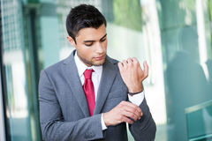 Business man adjusting his suit Stock Image