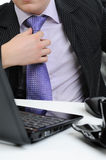 Business man adjusting his tie Royalty Free Stock Images
