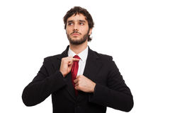 Business man adjusting his tie Stock Photo