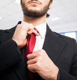 Business man adjusting his tie Stock Image
